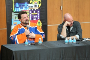 Kevin Smith laughing with AMC executive,  Joel Stillerman, in front of Montclair audience. MFF14