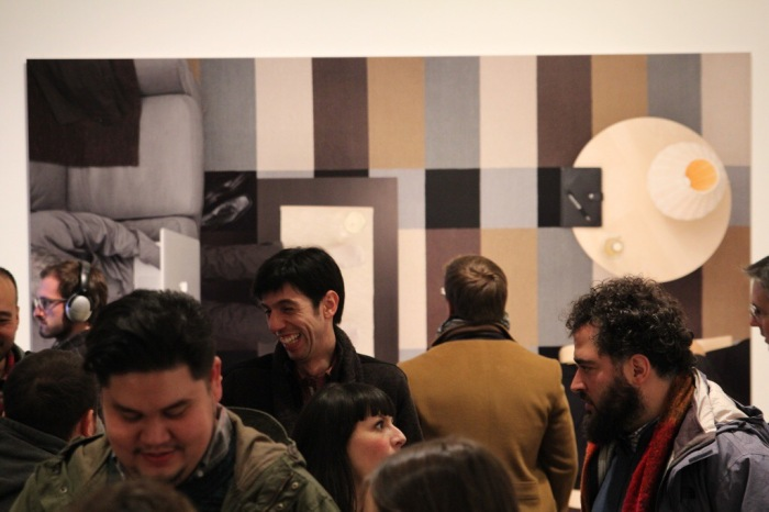 Gallery visitors viewing Margeaux Walter's works.